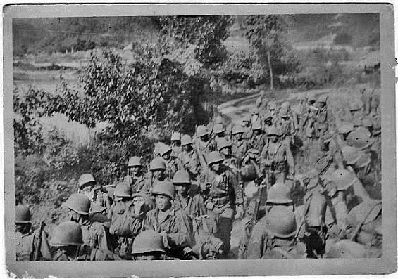 Men of the 10th BCT on the march in Korea.