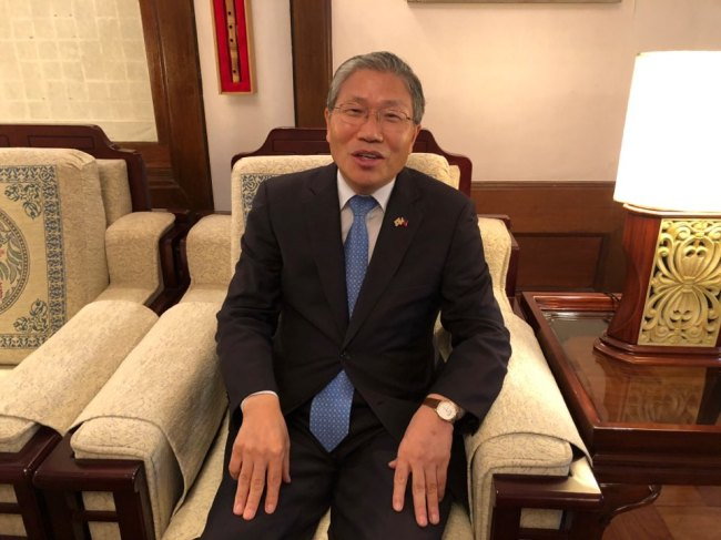 Korean-Ambassador-Han-Dong-man-seated