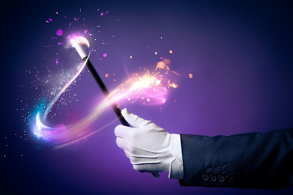 High contrast image of magician hand with magic wand